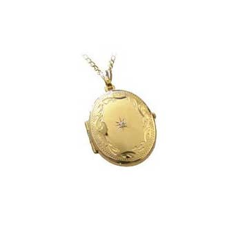 Diamond set and hand engraved oval locket in 9ct yellow gold.